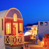 Traditional Greek house in Oia village on Santorini island at nightime