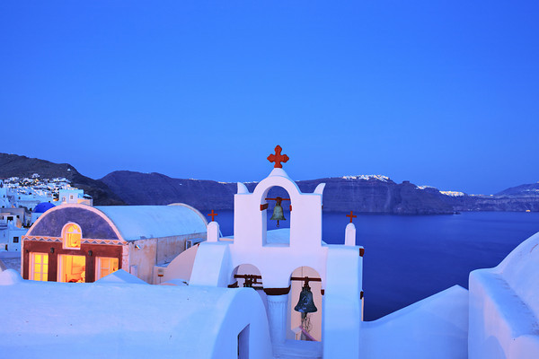 Church in Oia village on Santorini island, Greece at dawn