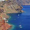 Boats in a bay on Santorini island, Greece