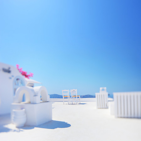 Minimalistic shot of two chairs shot on Santorini island