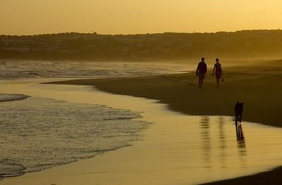 Evening stroll; beach; South Africa