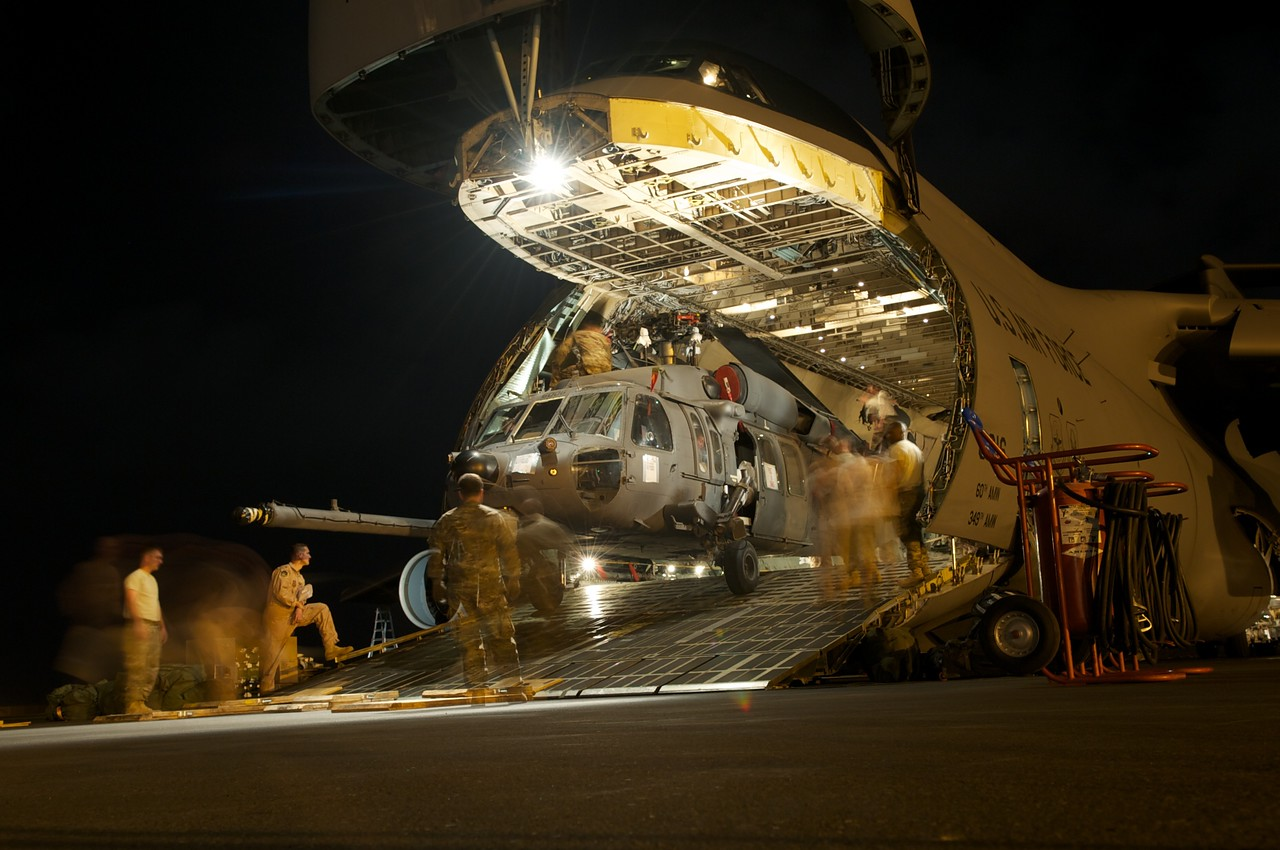 CAMP LEMONNIER, DJIBOUTI (Jan. 25, 2013) -Members of the 22nd Airlift Squadron from Travis Air Force Base and members of the new 303rd Emergency Rescue Squadron here, unload one of three HH60 helicopters from a C5 Galaxy.  The squadron is replacing the Heavy Marine Helicopter 464th Detachment A, who has been handling the mission here for the past ten years.  The arrival of the 303rd will better equip Combined Joint Task Force-Horn of Africa for personnel recovery due to the helicopters' capabilities.  This is one more tool that CJTF-HOA uses to be the preferred security partner of choice in an increasingly secure, stable, and developing East Africa. (U.S. Air Force photo by Staff Sgt. Jonathan Young)
