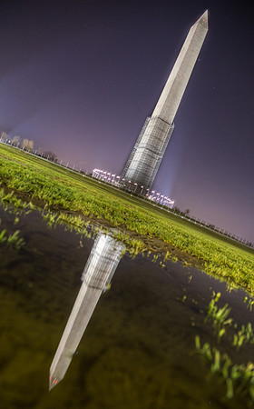 After getting to the Washington Memorial for shooting after a rain I found a great puddle that captured the memorial's reflection perfectly. I had to tilt my camera to the side to capture the whole scene though but I think it added a good twist.  http://ihitthebutton.com/washington-monument-puddle-reflection/