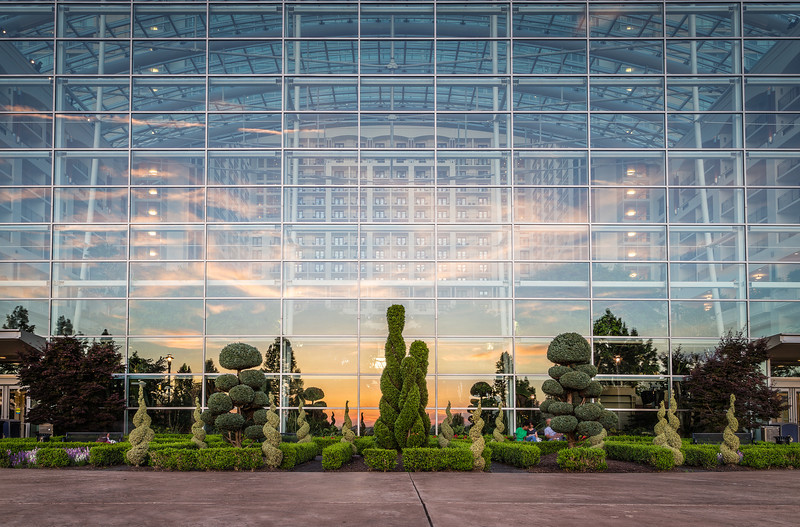"""Right when I saw the sunset glaring off the Gaylord at National Harbor I was floored. I love how you can see the Gaylord's grand interior along with the breathtaking sunset...<br /> <br />  <a href=""""http://ihitthebutton.com/sunset-reflection-at-gaylord-national-harbor/"""">http://ihitthebutton.com/sunset-reflection-at-gaylord-national-harbor/</a>"""