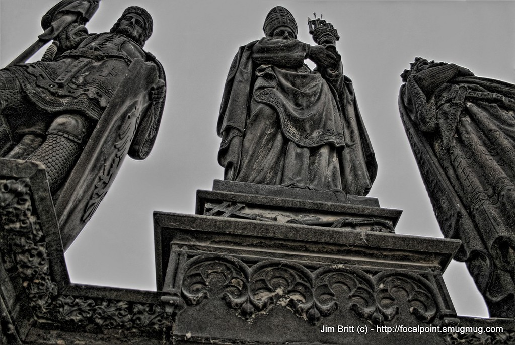 Statues of Prague (HDR)<br /> <br /> The bridge in Prague was literally covered with statues.  Everywhere you looked you could see an old statue.  I liked the perspective of this shot.