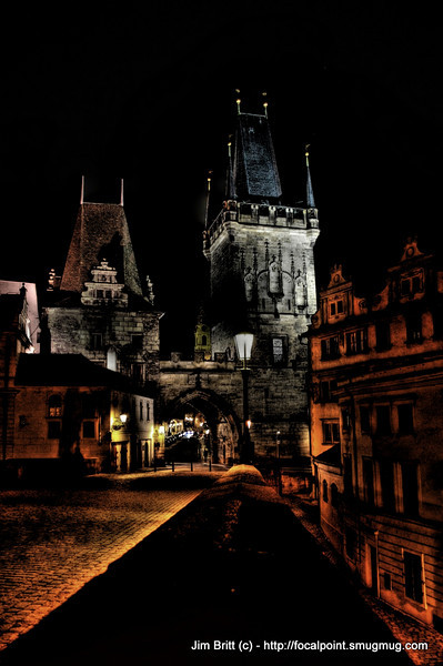 Night shot in Prague  (HDR)<br /> <br /> Taken one evening on a walk across a bridge in Prague.  They light up the buildings there which gives it a great mysterious look and provides subtle lighting for shots.  I sat my camera on a wall to take this shot and keep it still.