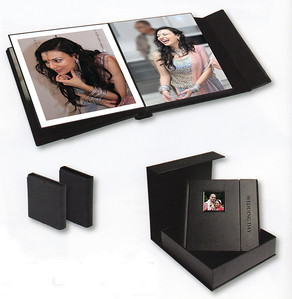 The exclusive Artimis albums form an exclusive range designed to accommodate 10x10 inch prints. They are supplied with the option of 10,15, or 20 spreads(20,30 or 40 pages) There is a small cameo apeture in the front of the album for your desired image and you can choose between lustre and gloss finish for your prints. Artimis albums are packaged in a contemporary velvet-lined black presentation box with sumptuous leather effect covering the outer surface