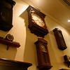 Majapahit dining room wall with old clocks.