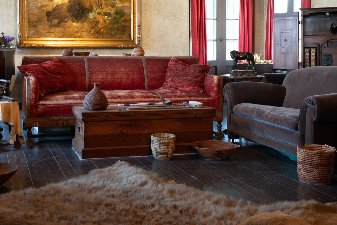 Living room with bearskin rug in the foreground.
