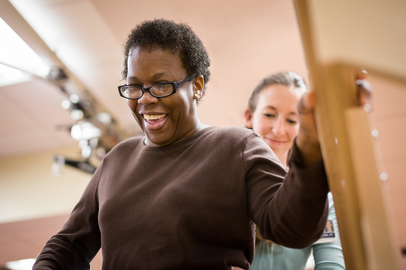 African American Female Patient Smiling During Physical Therapy