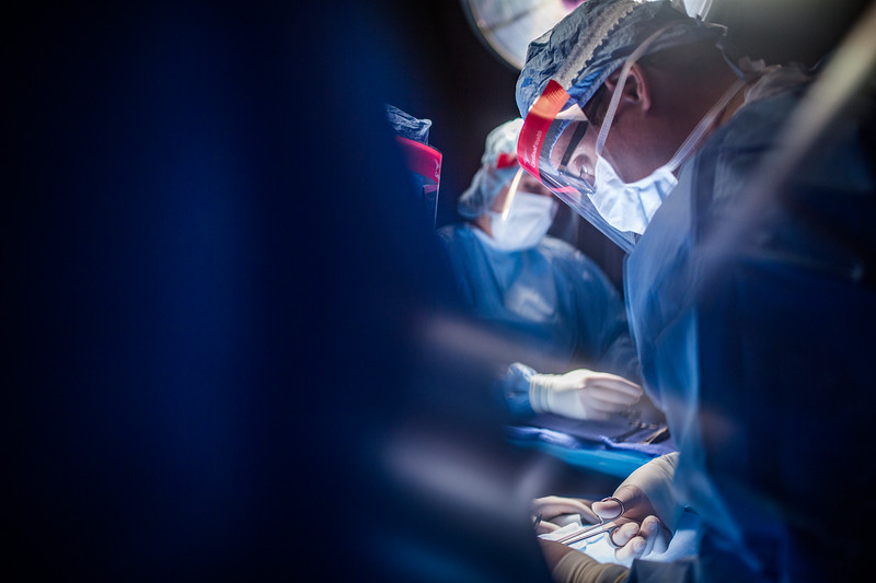Surgeon Using Operating Scissors During Surgery