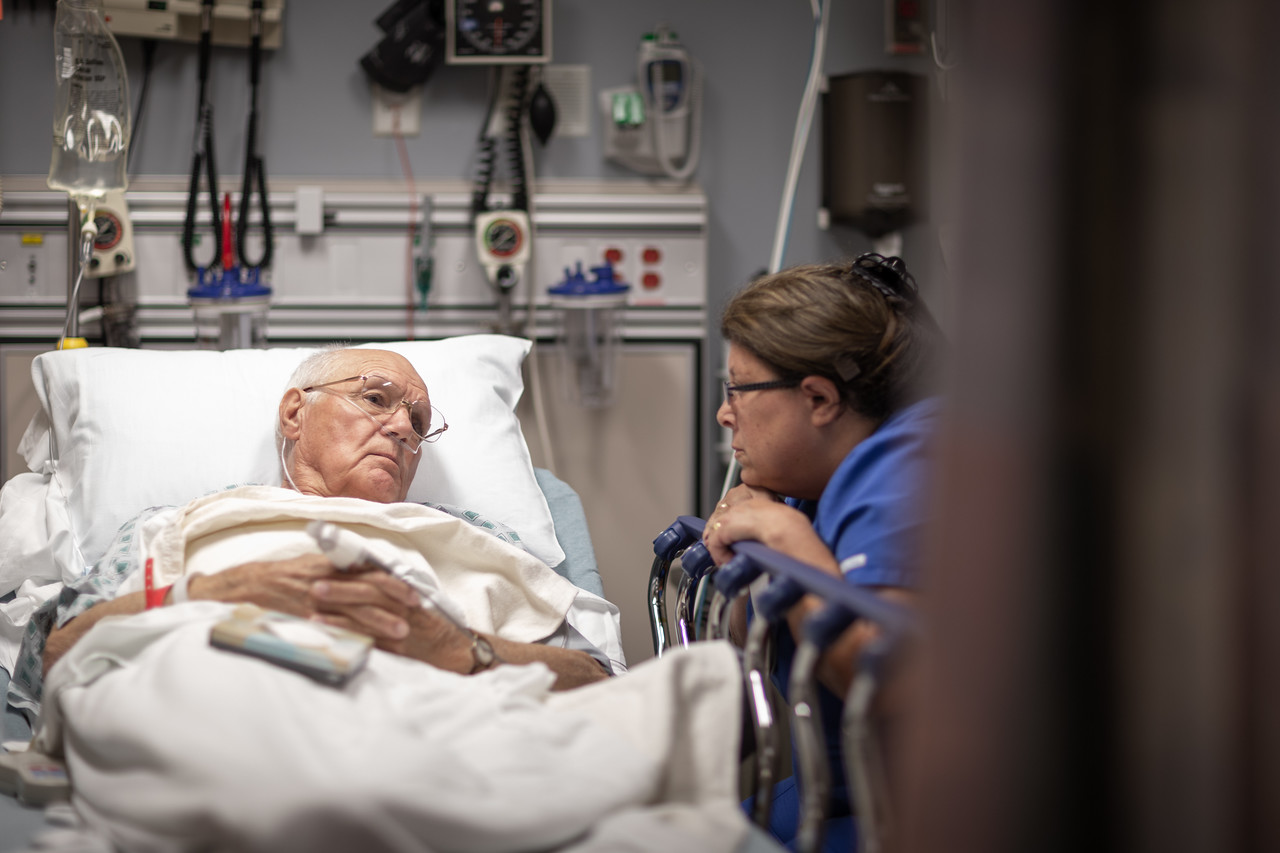 Nurse Spending Time with Concerned Patient in Room
