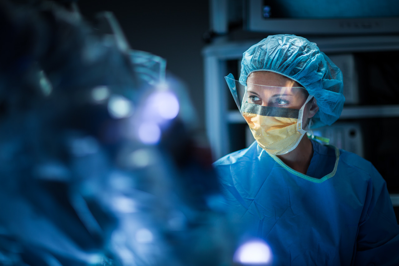 Focused Surgical Technician Wearing Face Shield