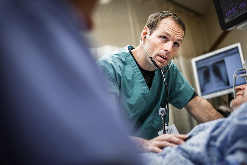 ER Doctor Concentrating While Taking Vitals