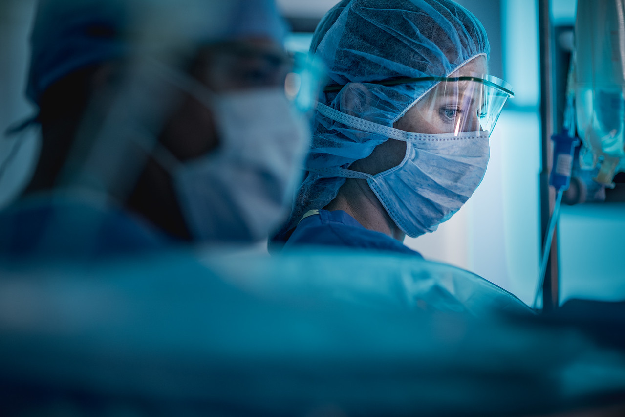 Surgical tech monitoring patient