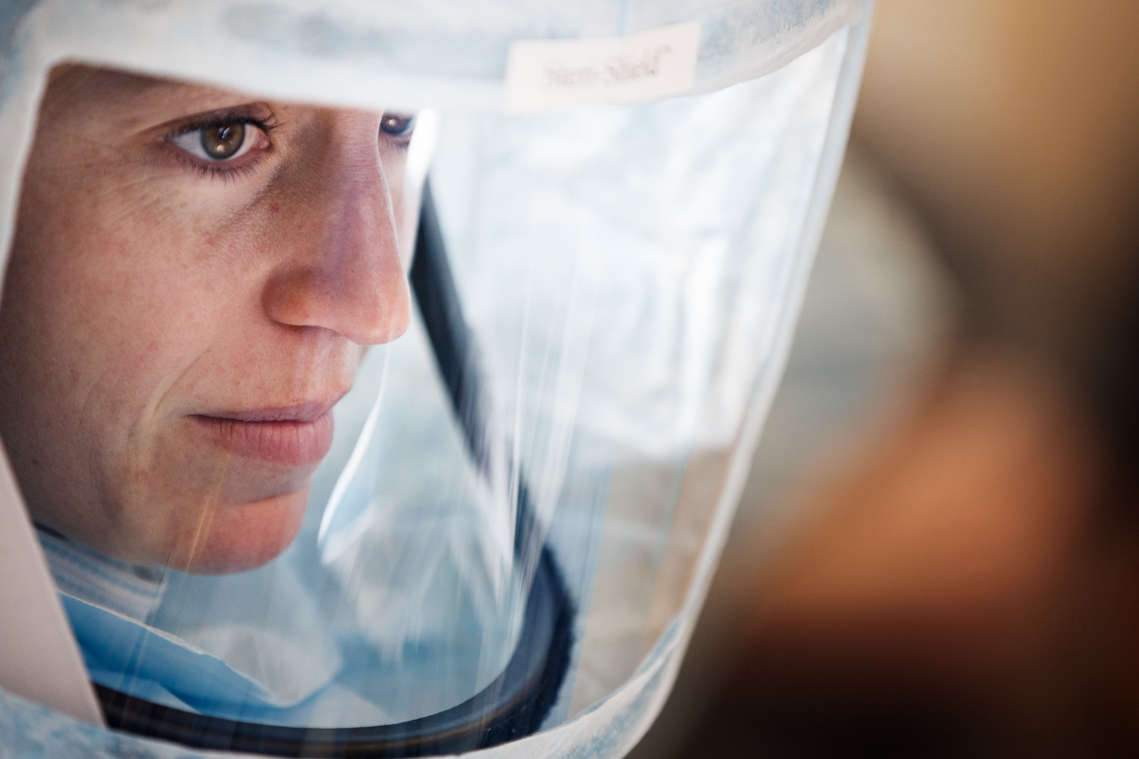 Extreme Closeup Concentrating Nurse Wearing Ortho Face Shield