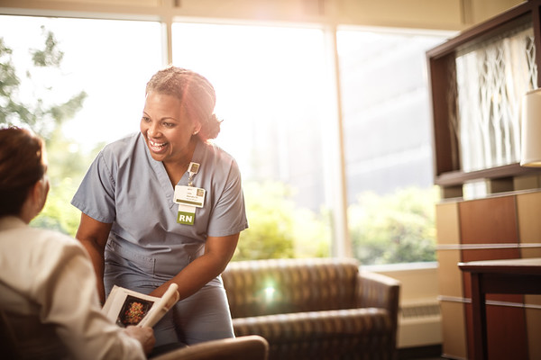 Nurse Greeting Patient in Sunny Lobby