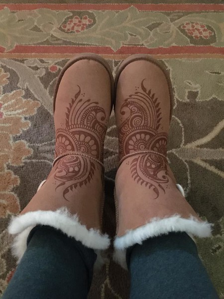 By using a wood burning tool, you can create designs of your choice to personalize your boots!  Always fun during the winter months..
