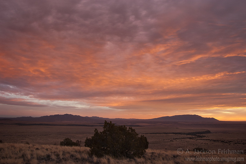 Sunset over the Ortiz and Sandia mountains from the Caja del Rio Plateau, New Mexico, February 2009.