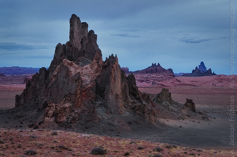 Gloomy dawn in Navajo country: Church Rock with Agathla Peak on the right, Arizona, March 2013.