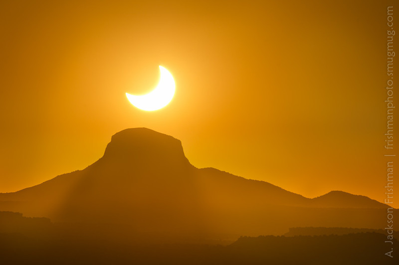 The solar eclipse of May 20, 2012 setting over Cabezon Peak, New Mexico. (Simple blend of two exposures for better foreground detail.)