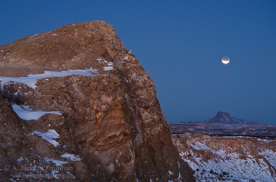 Lunar eclipse over White Mesa and Cabezon Peak, New Mexico, December 2011.