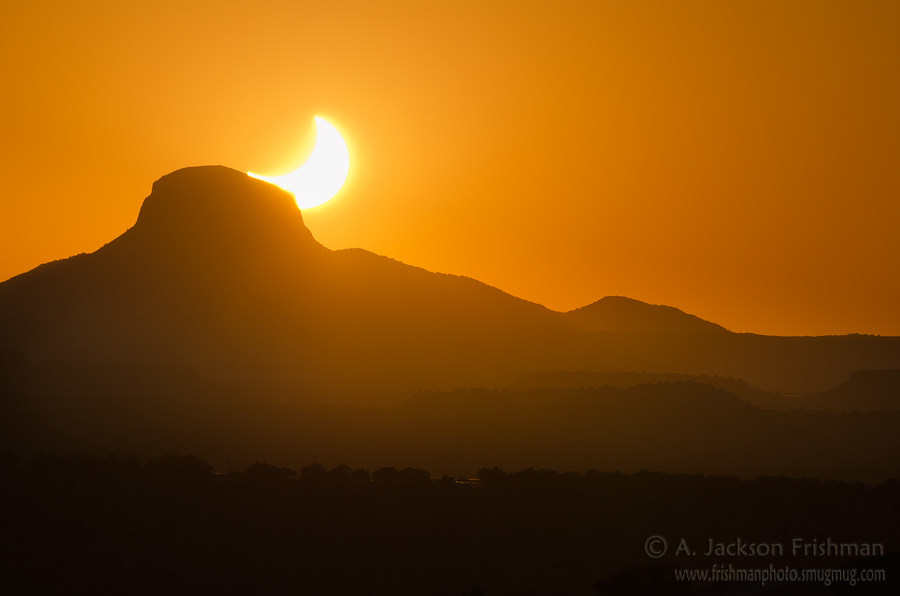 The solar eclipse of May 20, 2012 sinks behind Cabezon Peak, New Mexico.