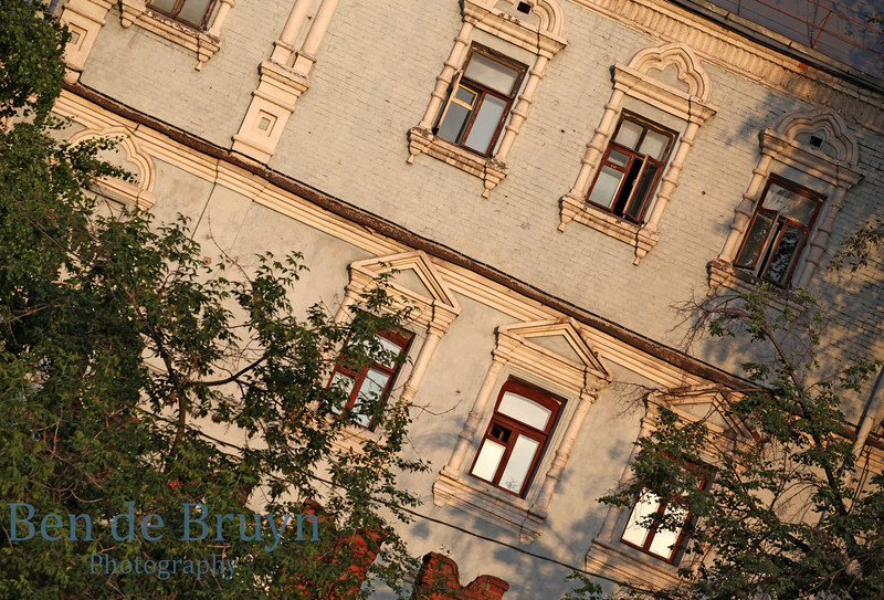 Traditional brick and weathered building with in late afternoon sunlight in Moscow Russia