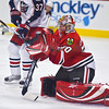 Corey Crawford #50 of the Chicago Blackhawks prepares to make a glove save in a preseason game against the Columbus Blue Jackets at the United Center on September 23, 2008. The Blackhawks won the game 4-3. (Photo by Chris Jerina)