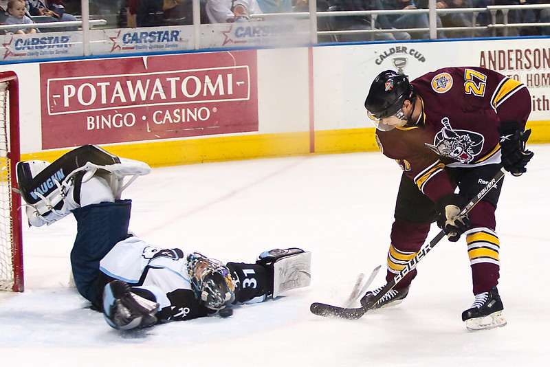 Mark Dekanich #31 of the Milwaukee Admirals makes a save with his mask from a shot by Johnny Pohl #27 of the Chicago Wolves during a game at the Bradley Center on April 9, 2010. The Admirals won the game 8-1. (Photo by Chris Jerina)