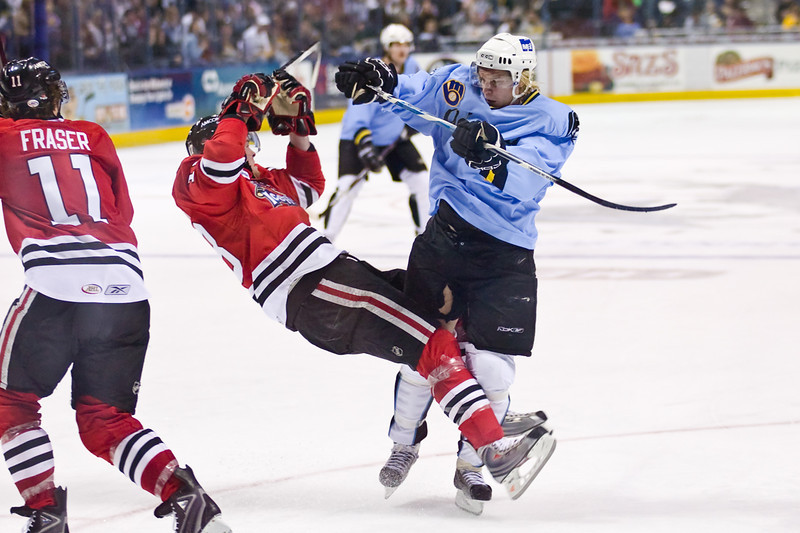 Antti Pihlstrom #40 of the Milwaukee Admirals knocks down a Rockford Icehogs player in a game at the Bradley Center on January 12, 2008. The Icehogs won the game 3-2. (Photo by Chris Jerina)