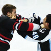 Wacey Rabbit #40 of the Milwaukee Admirals trades punches with Adam Hobson #23 of the Rockford Icehogs in a game at the Rockford MetroCentre on December 26, 2009. The Icehogs won the game 4-2. (Photo by Chris Jerina)