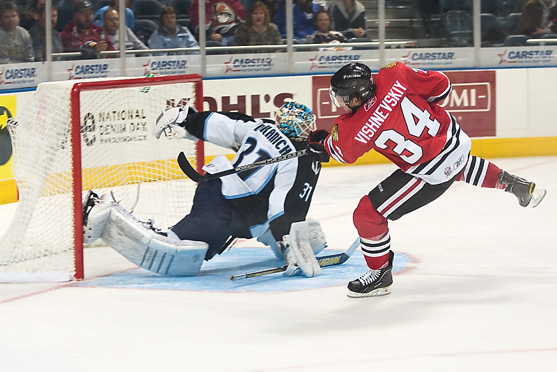 Ivan Vishnevskiy #34 of the Rockford Icehogs shoots the puck into the back of the net past Mark Dekanich #31 of the Milwaukee Admirals in a game at the Bradley Center on November 3, 2010. The Icehogs won the game 3-2. (Photo by Chris Jerina)