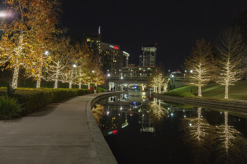 Beautiful night lighting in December on the Woodlands Waterway, in The Woodlands, Texas.