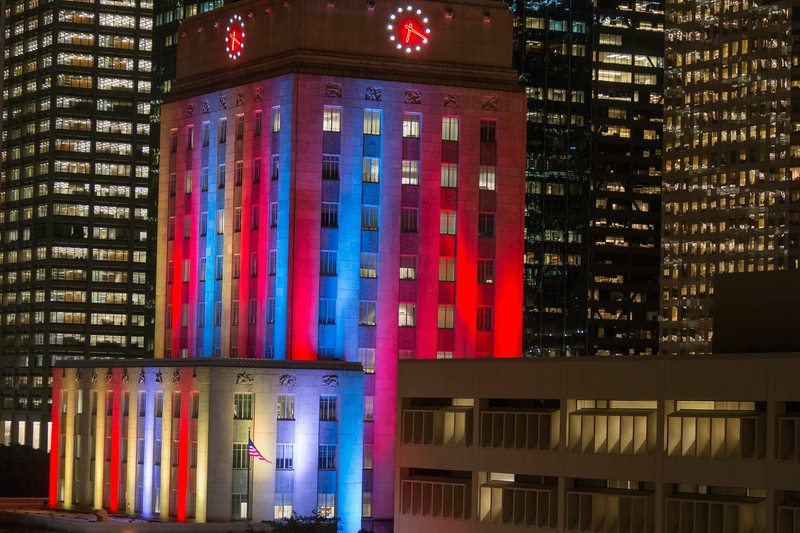 Houston City Hall with colored ligths at night.