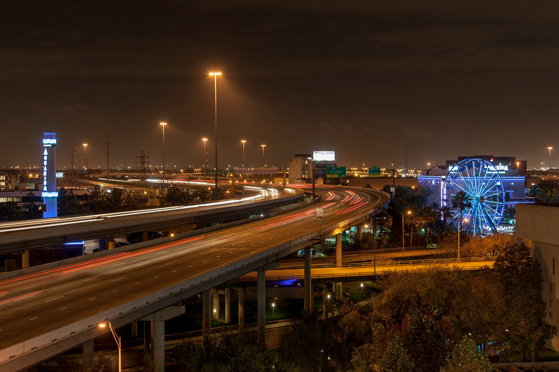 Streaking car lights at night on Interstate 45 in downtown Houston, Texas.