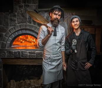 Portrait-of-chefs-in-brick-oven-kitchen