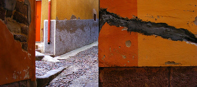 This looks like a bunch of photographs stuck together. But it isn't , it was just a strange juxtaposition of brightly painted walls in an alleyway.