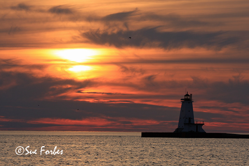 Sunset, Ludington Lighthouse<br /> Sunset over Ludington Lighthouse, Lake Michigan