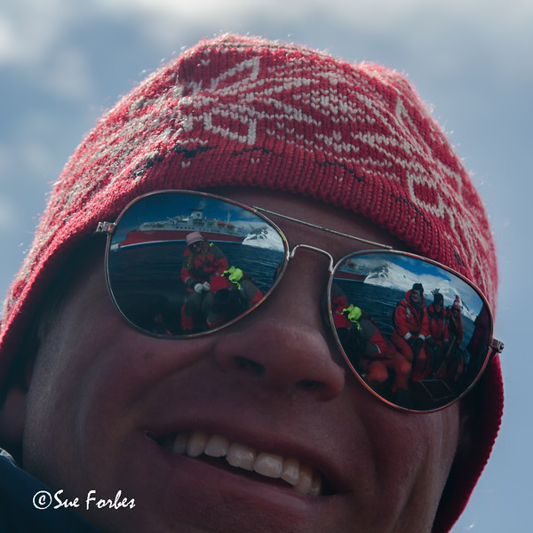 Expedition staff reflected in Alex's glasses