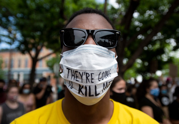 "Mark Clark, of Fort Collins, wears a face mask with the phrase ""They're going to kill me"" written on it during a protest in Old Town Square in response to the police killing of George Floyd, an unarmed black man in Minneapolis, in Fort Collins, Colo. on Tuesday, June 2, 2020."