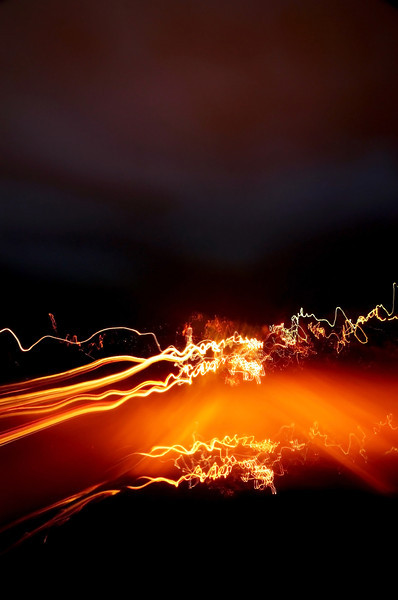 Photo experiment while driving.  This is a 2 minute exposure resting the camera on my steering wheel.  Kinda neat?