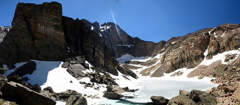 Pano Shot of Chasm Lake just below Longs Peak.  It's nice to still have places with snow I can hike to in the middle of june.  I love Colorado!<br /> <br /> Ended up getting a little sun flare in the photo.  I tried to block the sun flares with my hand, but I must have missed one of the frames with out realizing.