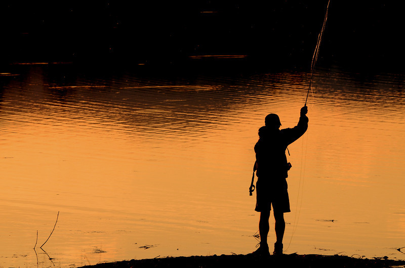 After an entire evening with no interesting shots - I see a man fishing at here at Walden Ponds with the sun setting and pretty much creating the perfect silhouette photo opp.  This is the very last image I took today before I hopped in the jeep and headed home :)
