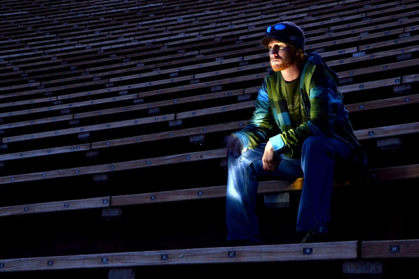 Waiting for an Encore -     Went to do a photo shoot with my photo group at Red Rocks  Amphitheater.  The focus of the session was to concentrate on leading lines in your composition.  I did this self portrait at the very end of the afternoon just after the sun went down.  I lit myself up with a flashlight as I sat in the empty bleachers.
