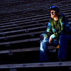 Waiting for an Encore -   <br /> <br /> Went to do a photo shoot with my photo group at Red Rocks <br /> Amphitheater.  The focus of the session was to concentrate on leading lines in your composition.  I did this self portrait at the very end of the afternoon just after the sun went down.  I lit myself up with a flashlight as I sat in the empty bleachers.