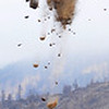 The sky is falling!  (A Vertical Pano shot of an air mulch drop over the 6000 acre fourmile burn area from last september)