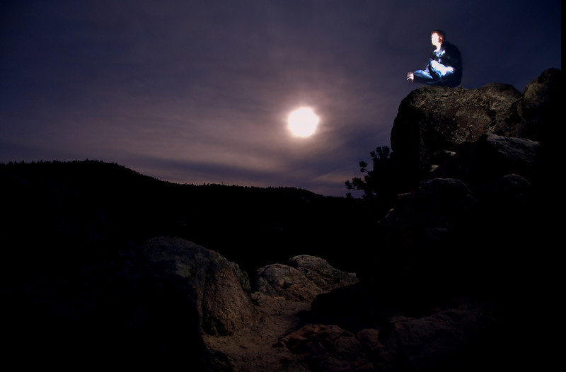 Another self portrait in the moonlight.  Looking for some critiques how to make it better.<br /> <br /> All the lighting of myself and the rocks was from the flashlight I was holding in my hand.