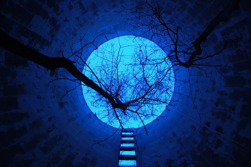 I built a step ladder to the moon and took a picture!! <br /> <br /> <br /> This is actually just the inside of an abandoned grain silo with a heavy heavy incandescent white balance set on the camera for a blue tint.