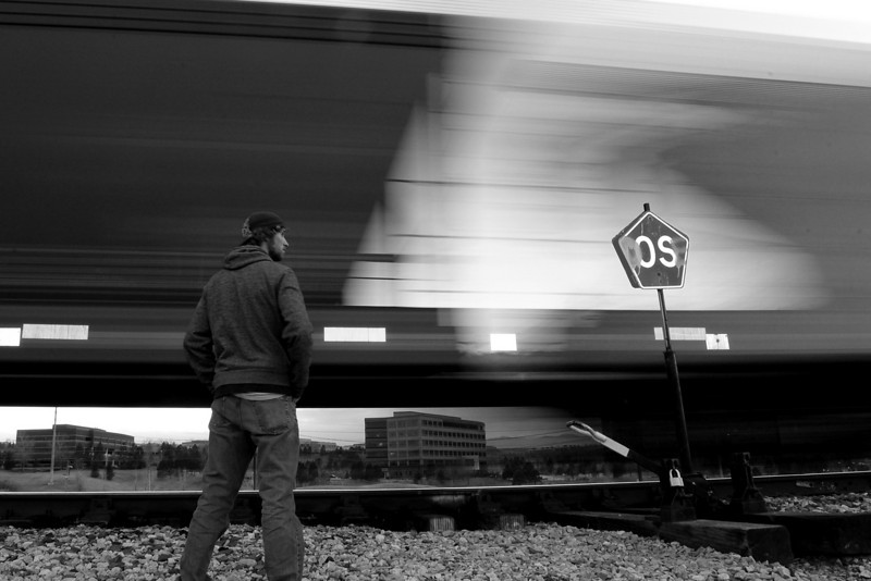 Self portrait long exposure in front of a moving train. Looking for some critiques and feedback